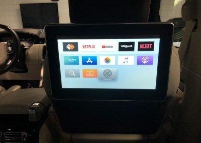Beeld van een apple tv in je auto